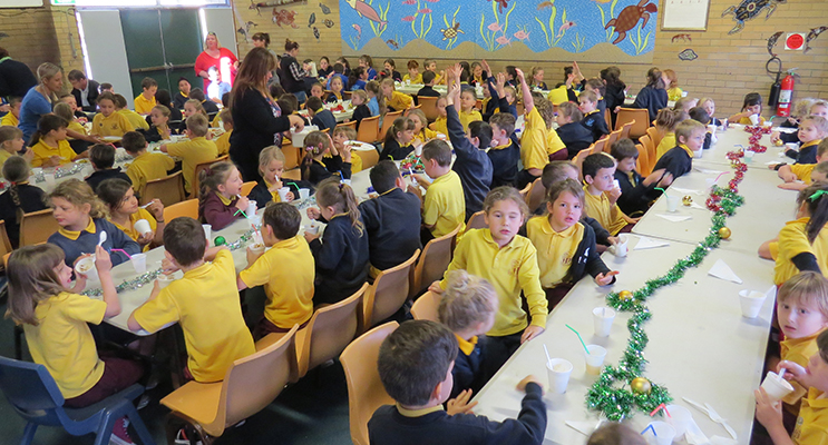CHRISTMAS LUNCH: Over 130 students enjoy Christmas lunch together.