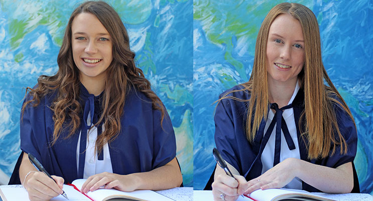 SIGN OUT: Chloe Lamborn signs the Graduation Book. (left) Emily Kirkpatrick signs the Graduation Book. (right)