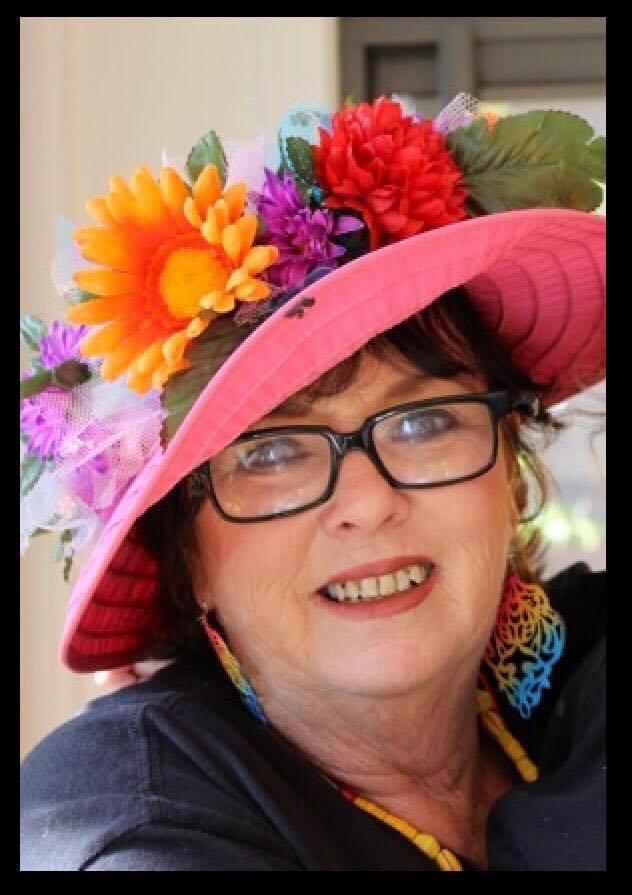 Judi Walker in her well known flower hat.  (Courtesy of Jewell Drury)