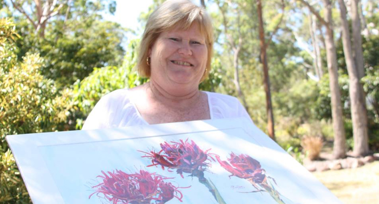 CREATIVE: Rhonda Roberts with art from last year. Picture: Stephen Wark