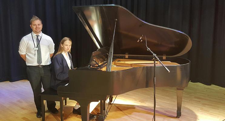 PERFORM: Emily Legge with music teacher Mr Brendan Wright.