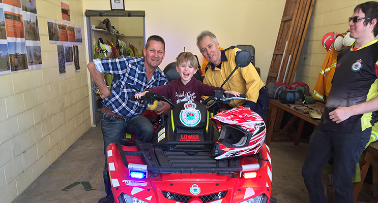 George Novotny and his Poppy try out the quad bike with Brigade member Chris Gavin.