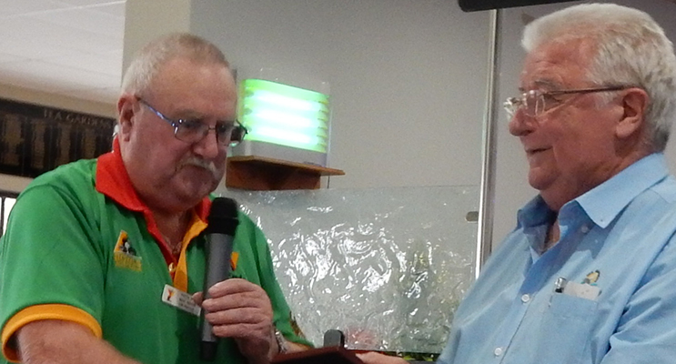 Peet-Ray Secretary/Chairman presenting a commemorative plaque to Country Club President Ken McKeown.