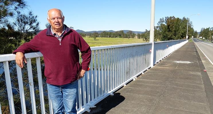 HONOUR: Dennis Syron proudly stands on the Nan Syron Bridge.