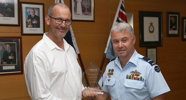 : Williamtown Blood Challenge Co-ordinator, Mr Samuel Hays presents Senior Australian Defence Force Officer – RAAF Base Williamtown, Air Commodore Craig Heap CSC, with the 2015 Australian Red Cross Blood Challenge Regional Trophy