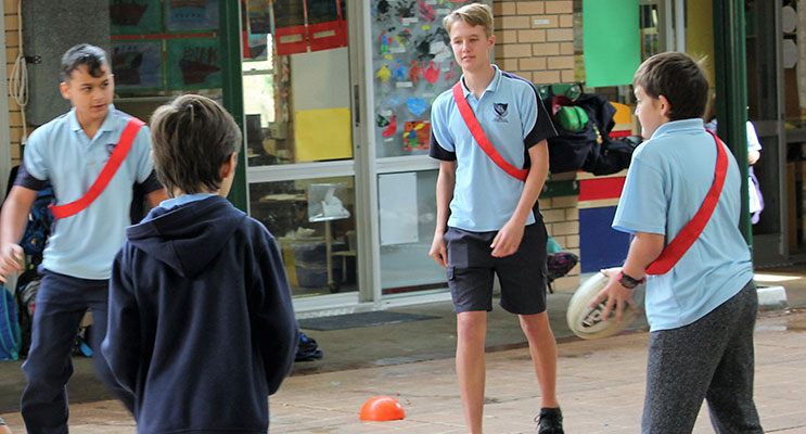 SPORT: BCS Year 10 student Luke Rochester referees a game.