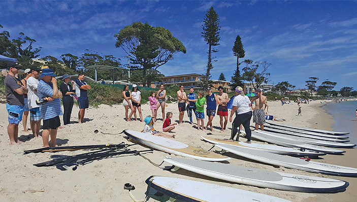 A beautiful day as the community learn how to Stand Up Paddleboard Photo: Shoal Bay SUP