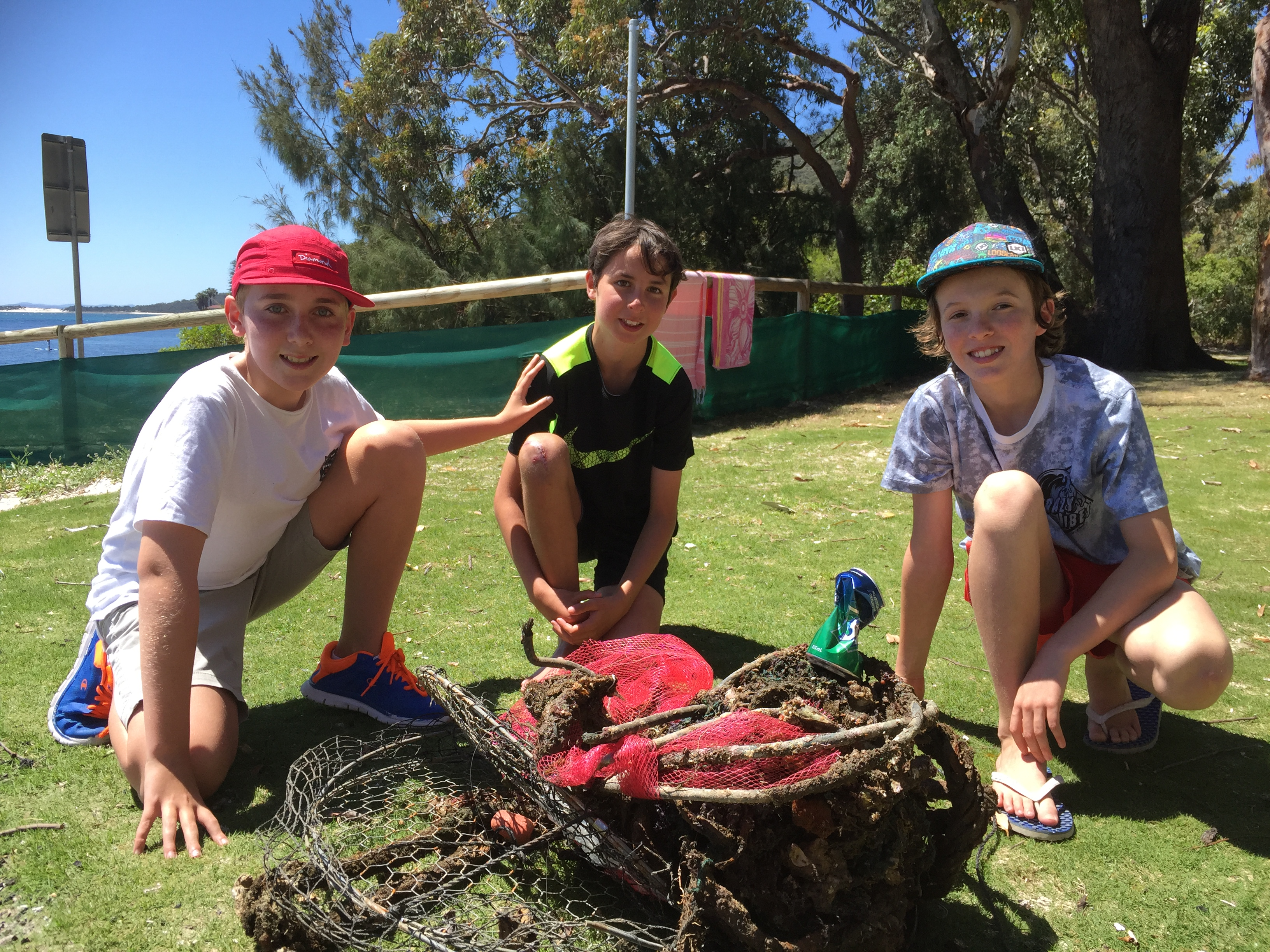 Oscar Bell, Samuel Finn and Troy Voyzey with rubbish collected from Nelson Bay Breakwall.