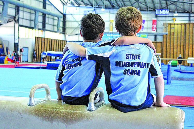The two Joshua's enjoying their love of Gymnastics together.