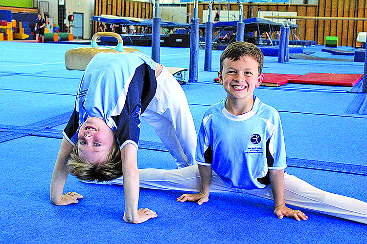 The two Joshua's enjoying their love of Gymnastics together.