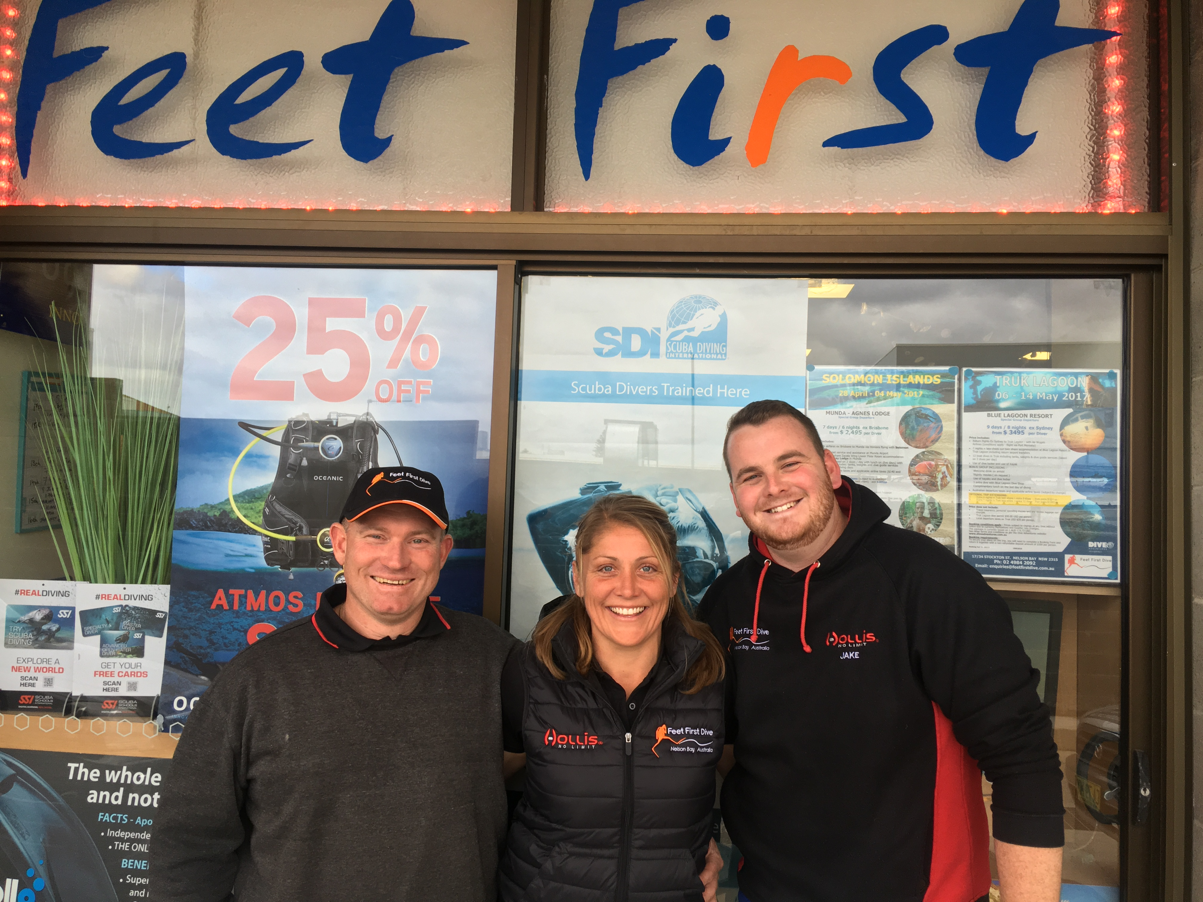 The team at Feet First Dive Nelson Bay, Phillip Campey, Trudie Blackett and Jake Harden are protesting the Aquaculture Farms location.