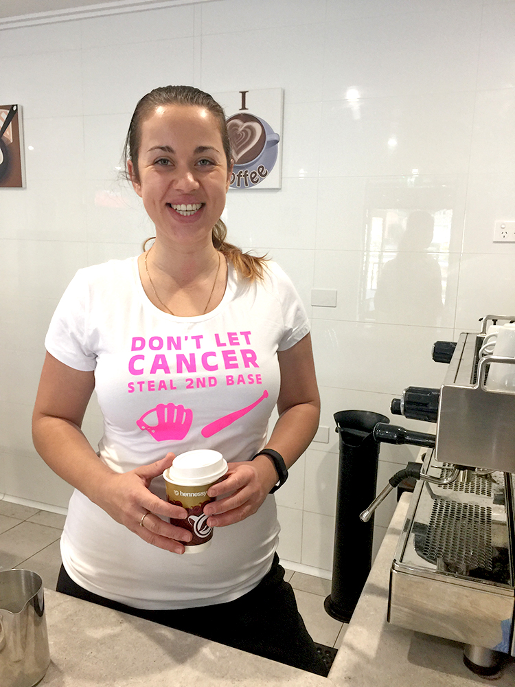 2.	Barista Hayley sporting her Breast Cancer Awareness shirt.