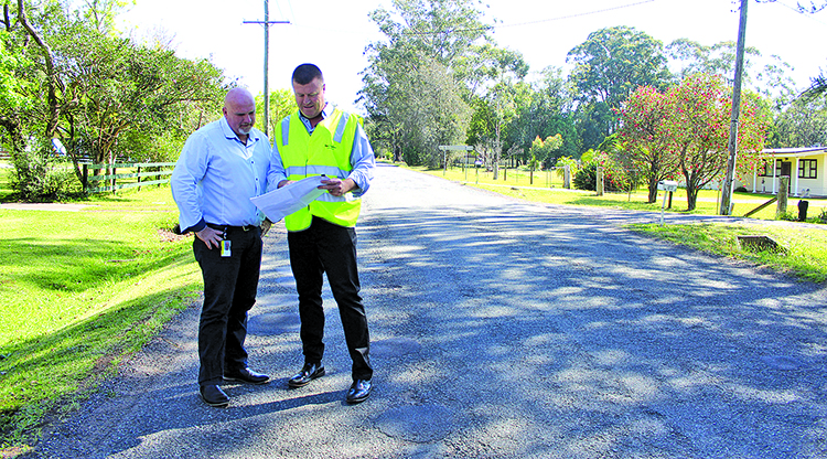 Deputy Mayor, Cr Chris Doohan and Greg Kable (Acting Group Manager Facilities and Services)  review plans for new road works at Abundance Road.