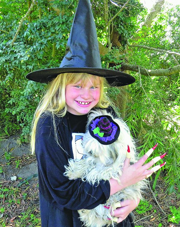 HALLOWEEN: Maggie Cunich with her dog Izzy.