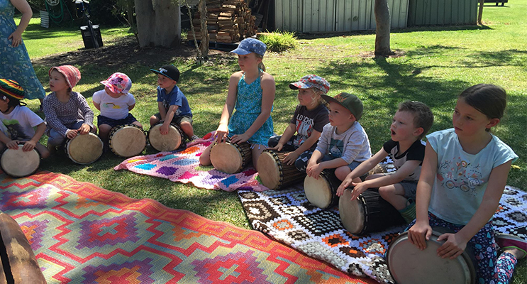 Children at the festival participating in a bongo workshop. Photo: Kim Oakhill