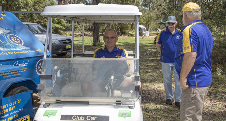 Don Whatham in the cart, Secretary of the Rotary Club.