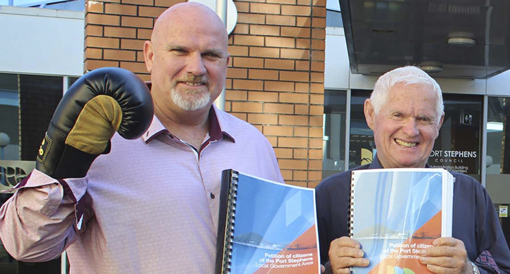 Councillor and Deputy Mayor Chris Doohan with Mayor Bruce MacKenzie holding Anti-merger petition orgainiser earlier this year.