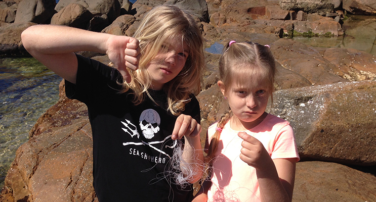 Luke and Sophie Stanhouse with the fishing wire they found.