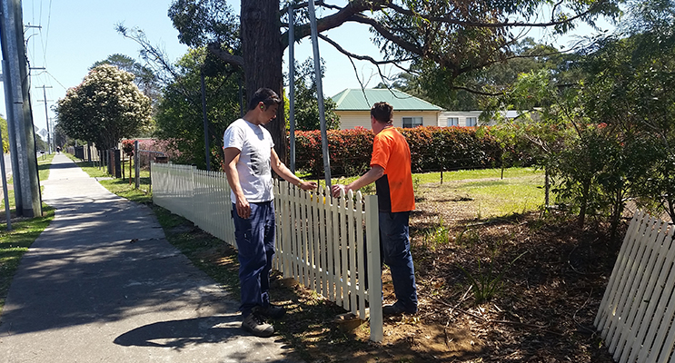 2.Volunteers working on the fence construction