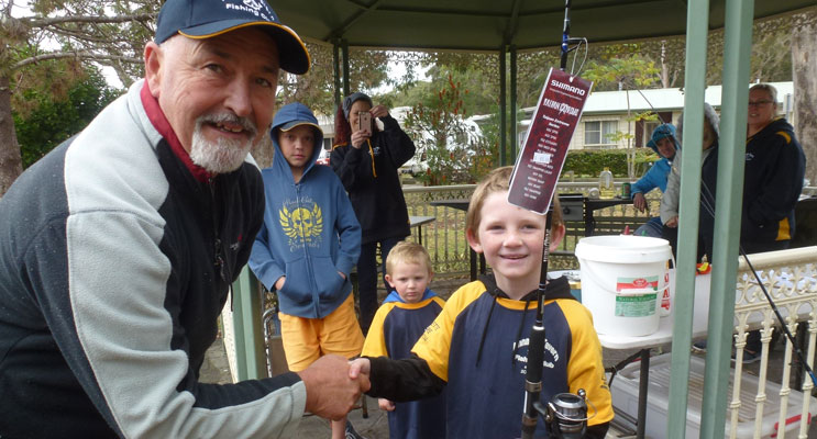Last year's Kids Comp Winner Coby Taylor receives his prize. Photo Warren Leadbeatter