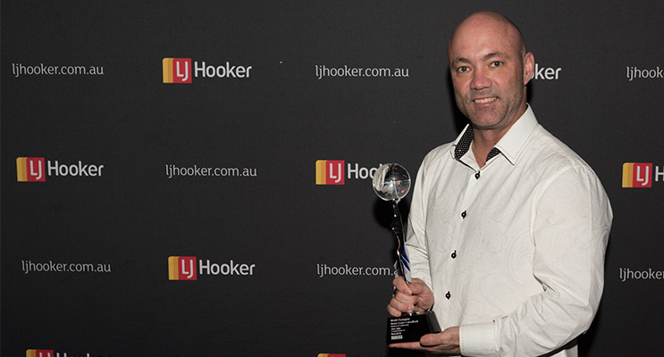 Ben Eick receives his World Champion Home Loans Consultant Award at LJ Hooker's Annual International Awards. Photo: Bec Dahl