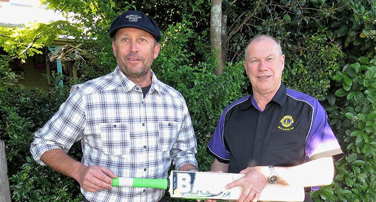STRIKE: Cricket bat signed by Michael Clarke