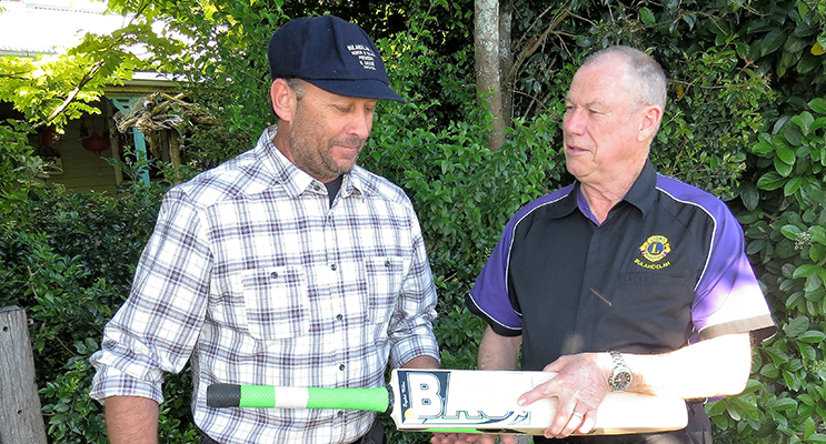 NEW INNINGS: Bradley Allen and Roger Dixon with the bat signed by Michael Clarke.