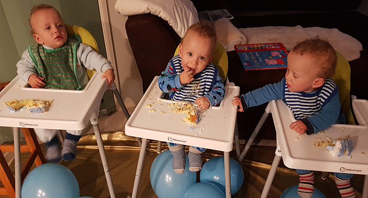 TRIPLE FUN: Triplets Kenny, Jackson and Will enjoy their birthday cake