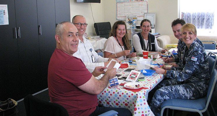 Members of Williamtown Craft Group working on their important Christmas craft