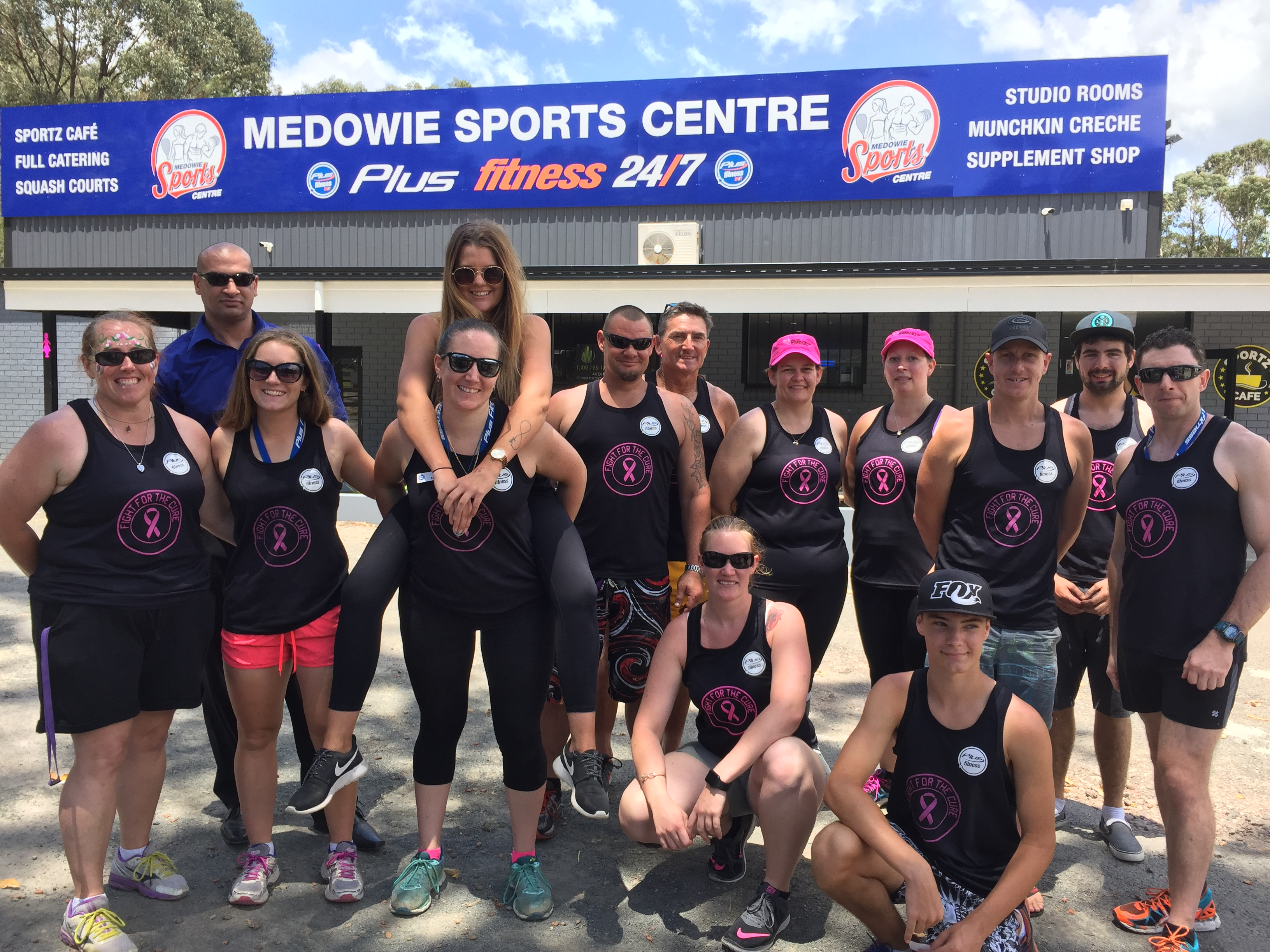 1.Staff and Clients in their Breast Cancer Fight for the Cure singlets.