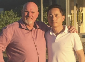 Cr Chris Doohan and new owner Wilson Hu.