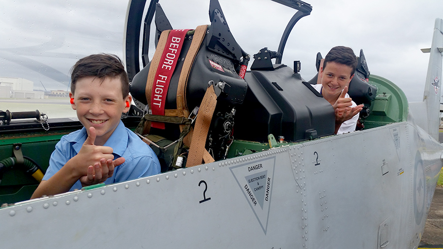 Josiah Hays, 10 and Ethan Hays, 13 in the seat of a Pilatus PC9 flown by 4SQN aircraft.