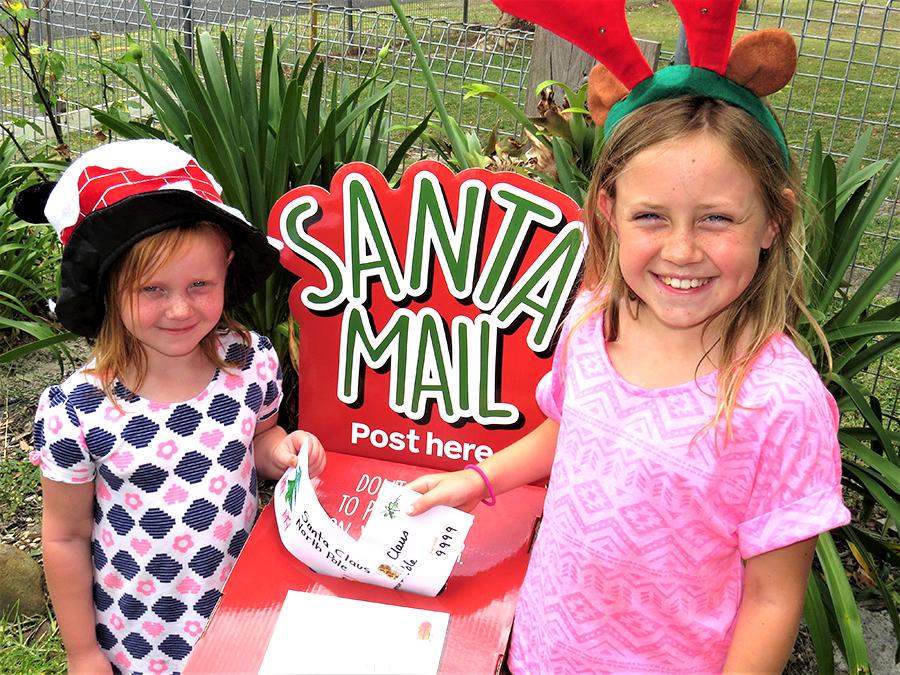 SANTA'S MAILBOX: Mia and Charlie Garemyn post their letters to Santa.