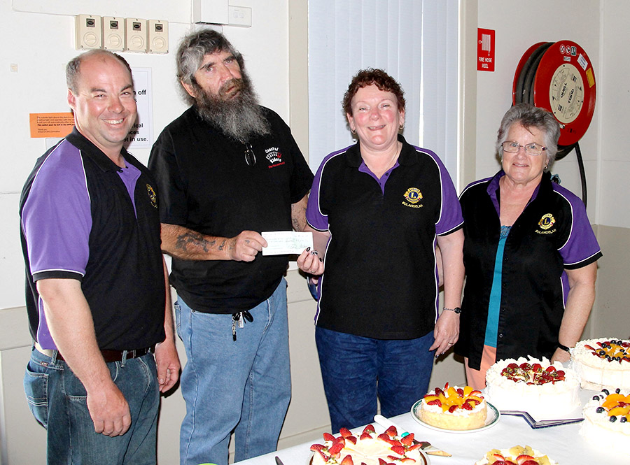 FUNDRAISER: Lion Ian Mason, Bulahdelah Hunting and Social Club Treasurer Greg Russell presenting a cheque to Lion Judy Dixon with Lion Anne Chisholm.