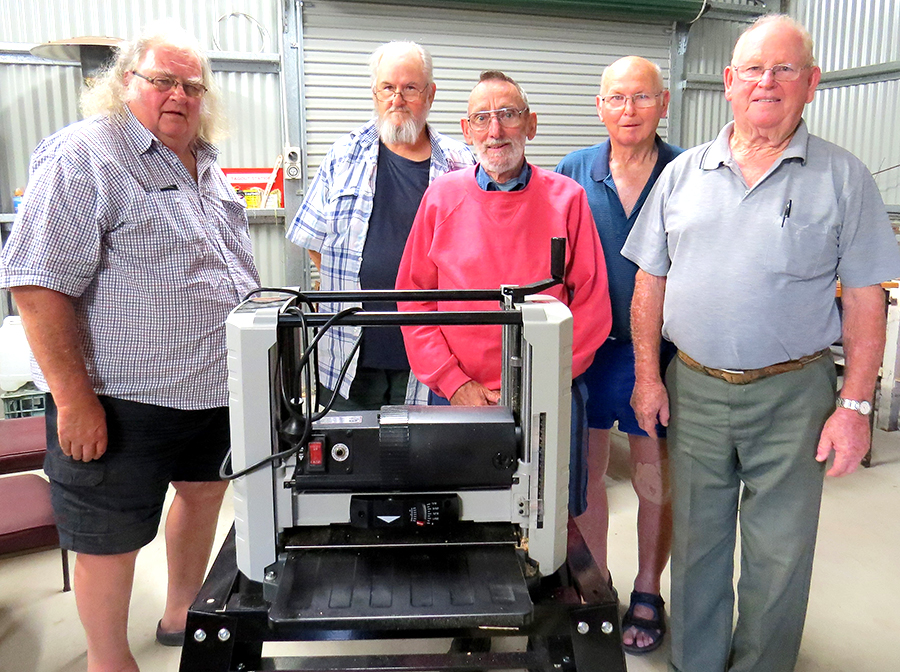 : MEN'S SHED: Neville Wing, Rick, Linnegar, Alan Simonds, Max Burrows and John Renfrew with the new Thicknesser.