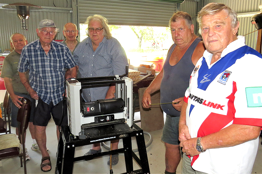 MEN'S SHED: Peter Millen, Jim Brown, Max Burrows, Neville Wing, Garry Haynes and Rodney Costall test the new Thicknesser.