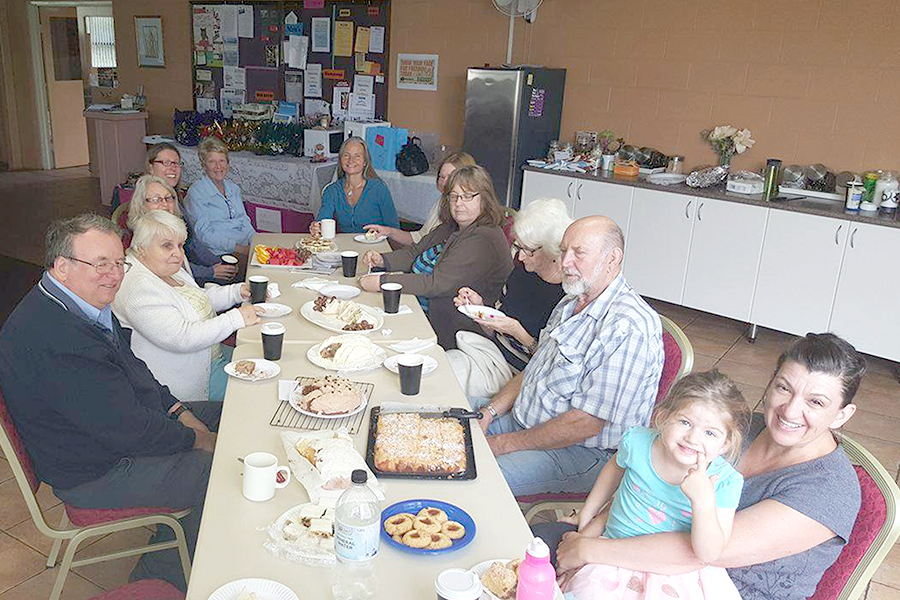 Members of the community enjoy this week's Cuppa and cakes. Photo By: Julie Bailey