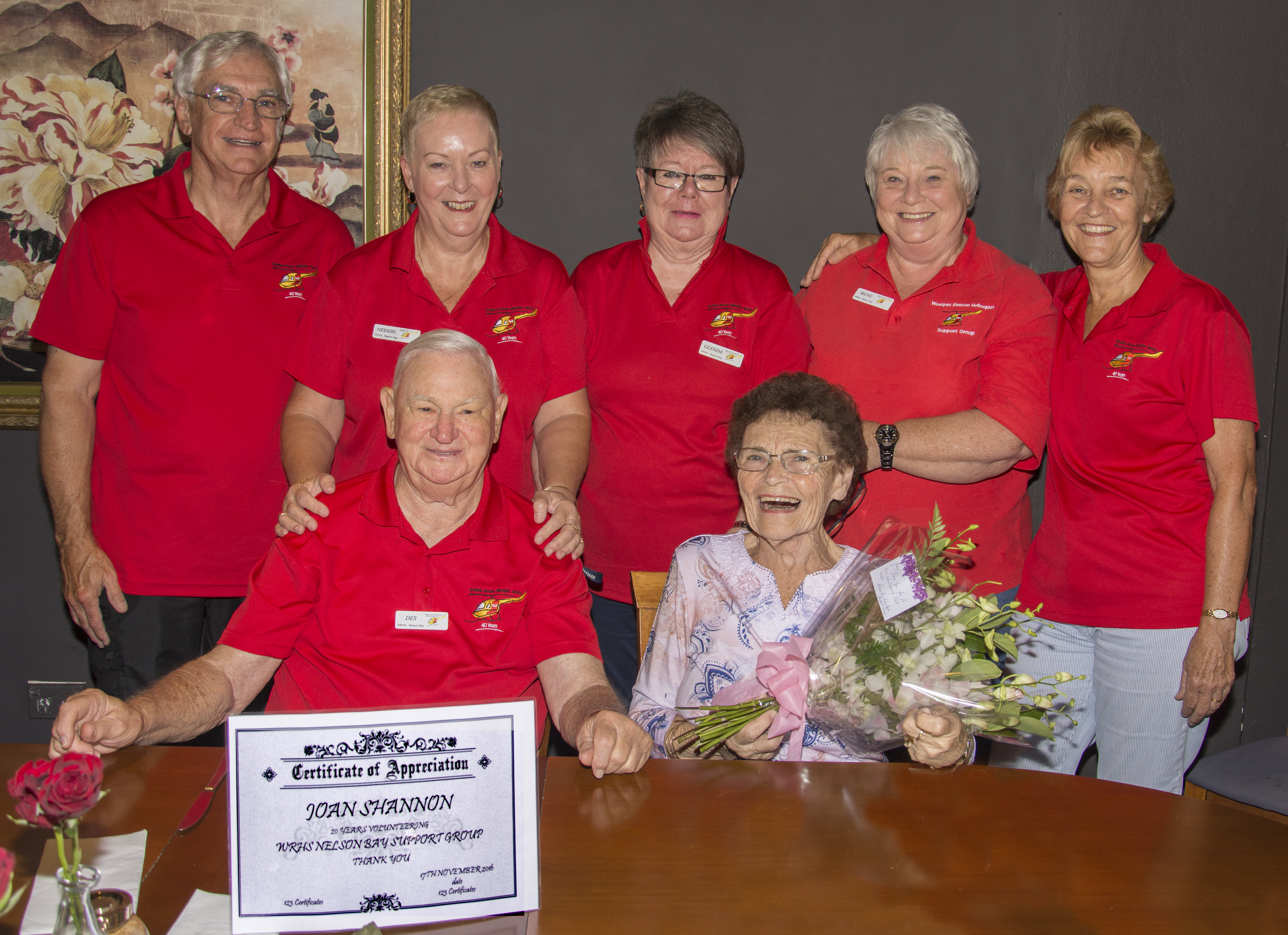 Joan Shannon surrounded by dedicated Westpac Helicopter volunteers. Photo by: Square Shoe Photography