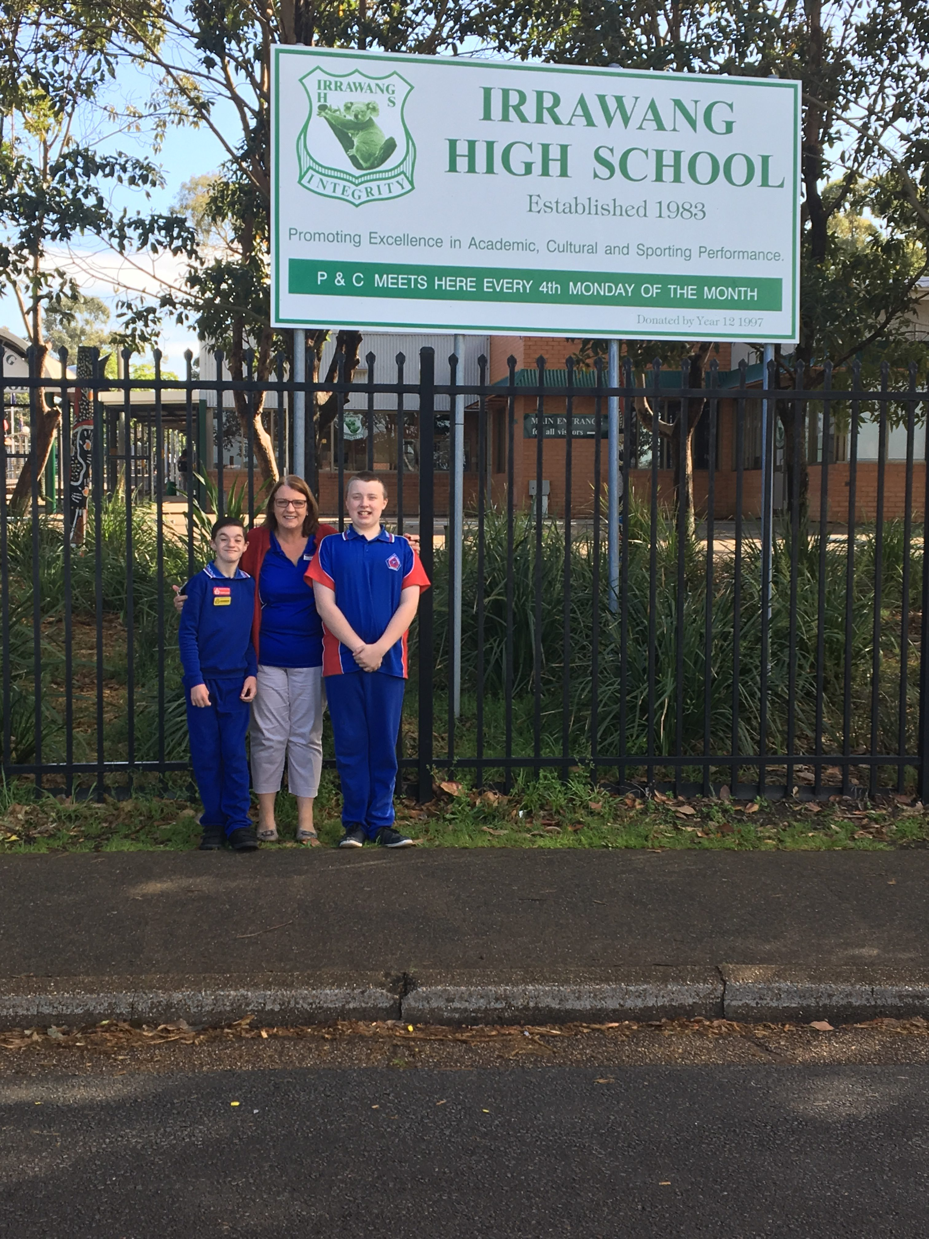 2.Otto and Joel with their Learning Support Teacher, Sue Marriott, outside Irrawang High School.