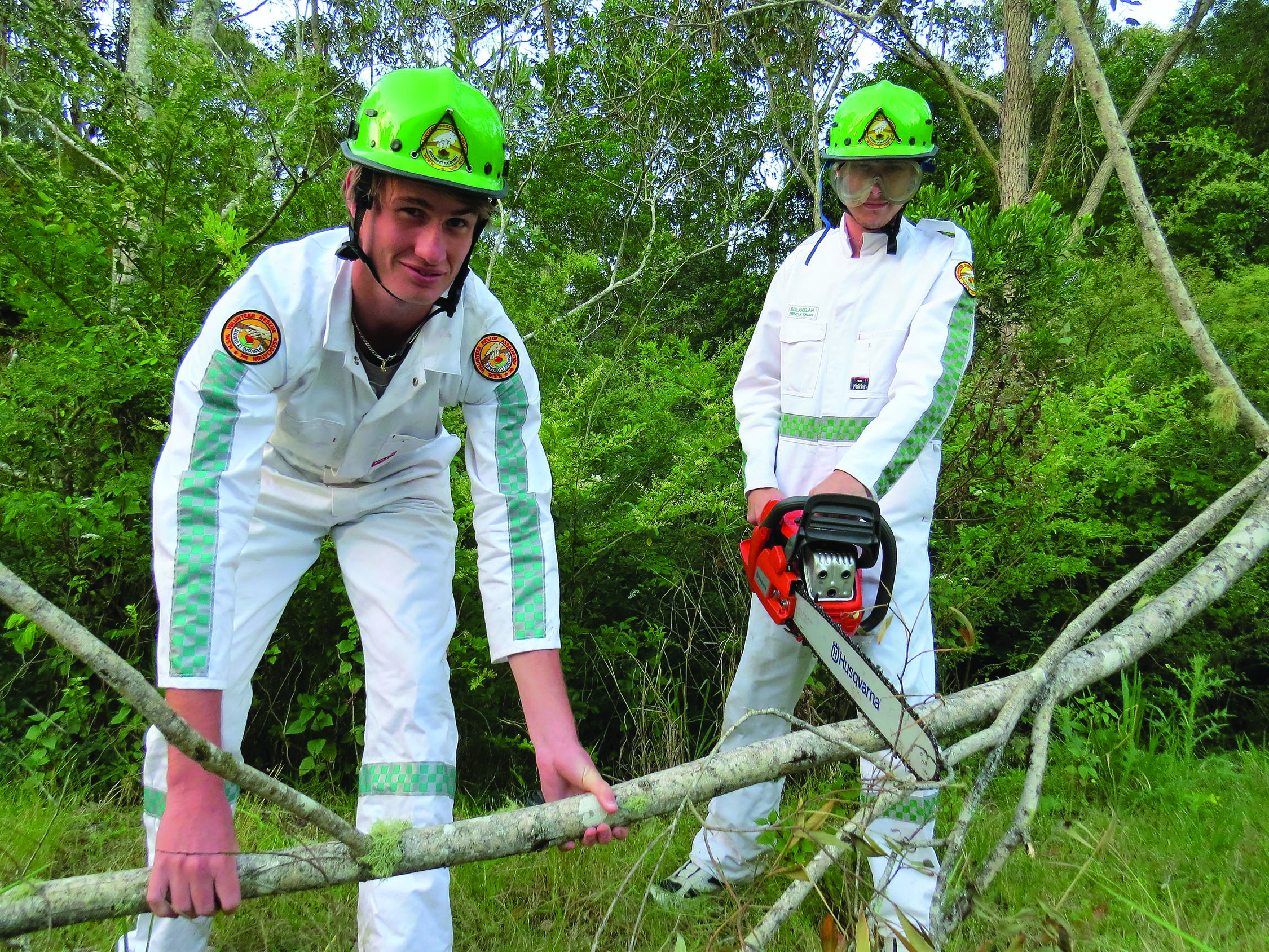 STORM PREPARATION: Bulahdelah VRA members Adams Crampton and Joseph Murray clear debris and overhanging branches.