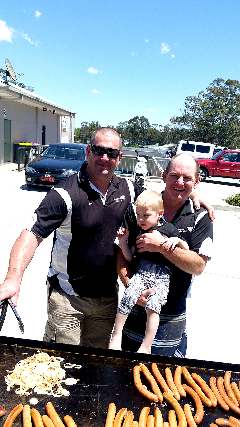 Ben and Shaun from Medowie Meats, with young Carter Goodwin.