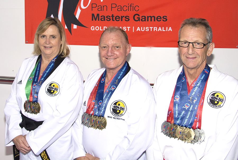 Liz Bergan, Ronald Bergan and Dave Kilroy of Him-Do Tae Kwon Do Academy with medals from Pan Pacific Masters Games.