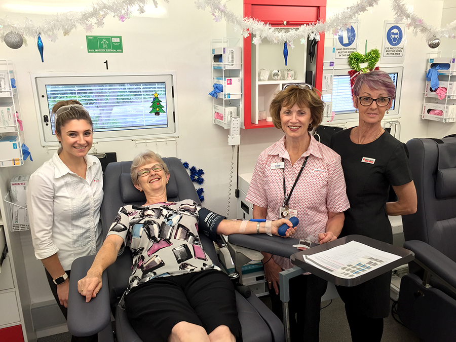 Libby Dingle donating her time to donate blood, assisted by nurses Kristina Cooper, Kerry Wood and Cynthia Bailey at the Mobile blood bank in Medowie this week.
