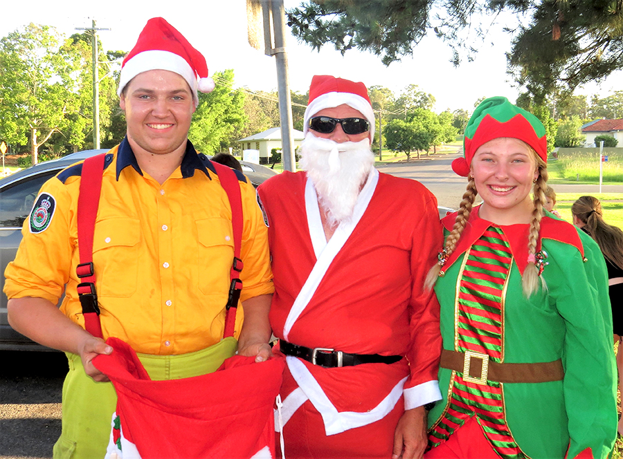 COMMUNITY CHRISTMAS: RFS members Jake Blanch and Meagan Terry with Santa.