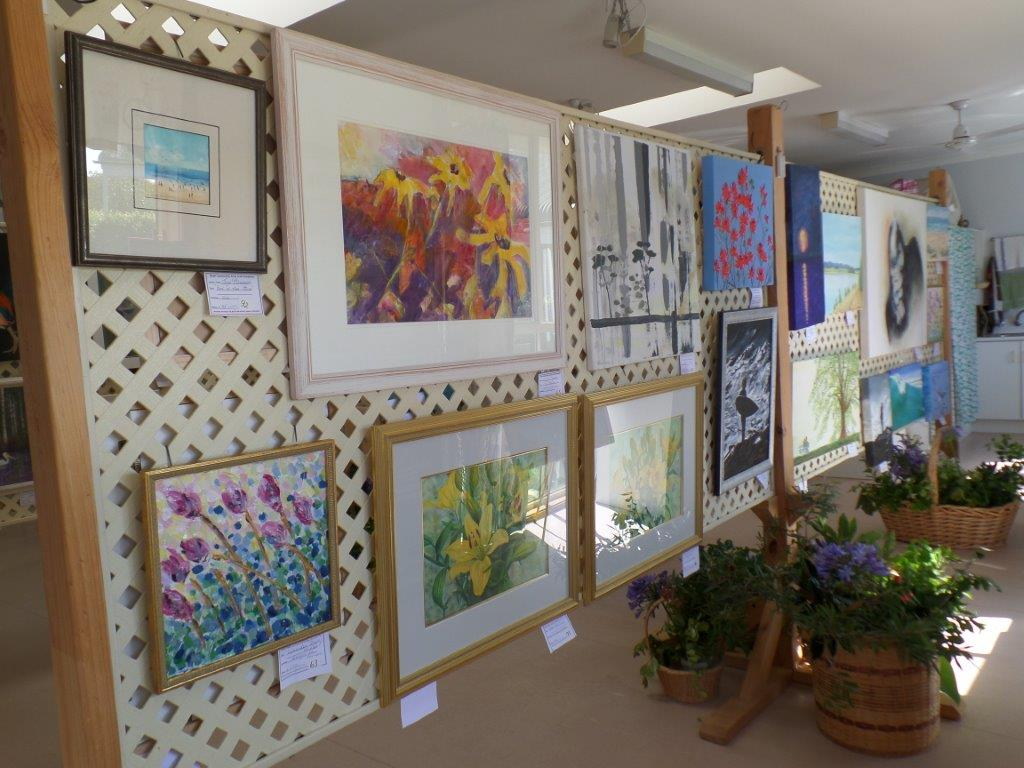 Paintings, prints and photography on display.