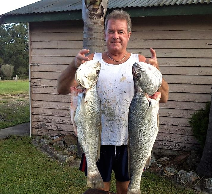 CATCH OF THE DAY: Brett Shultz with a couple of jewfish recently caught at the local beaches.
