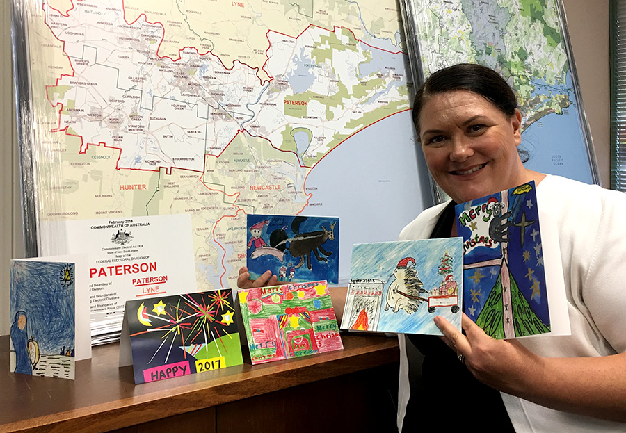 Meryl Swanson with her Christmas cards; the winner is on the right.