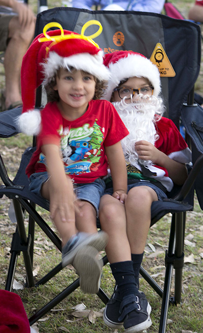 Santa Jnr and his assistant