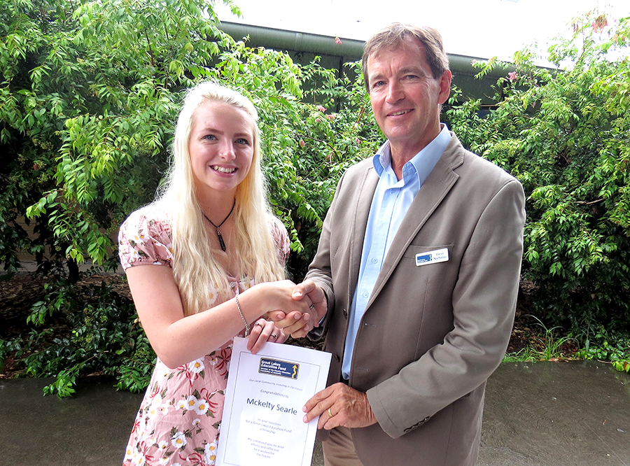SCHOLARSHIP: Mckelty Searle accepts her award from Great Lakes Education Fund Chairperson Stephen Nicholas.