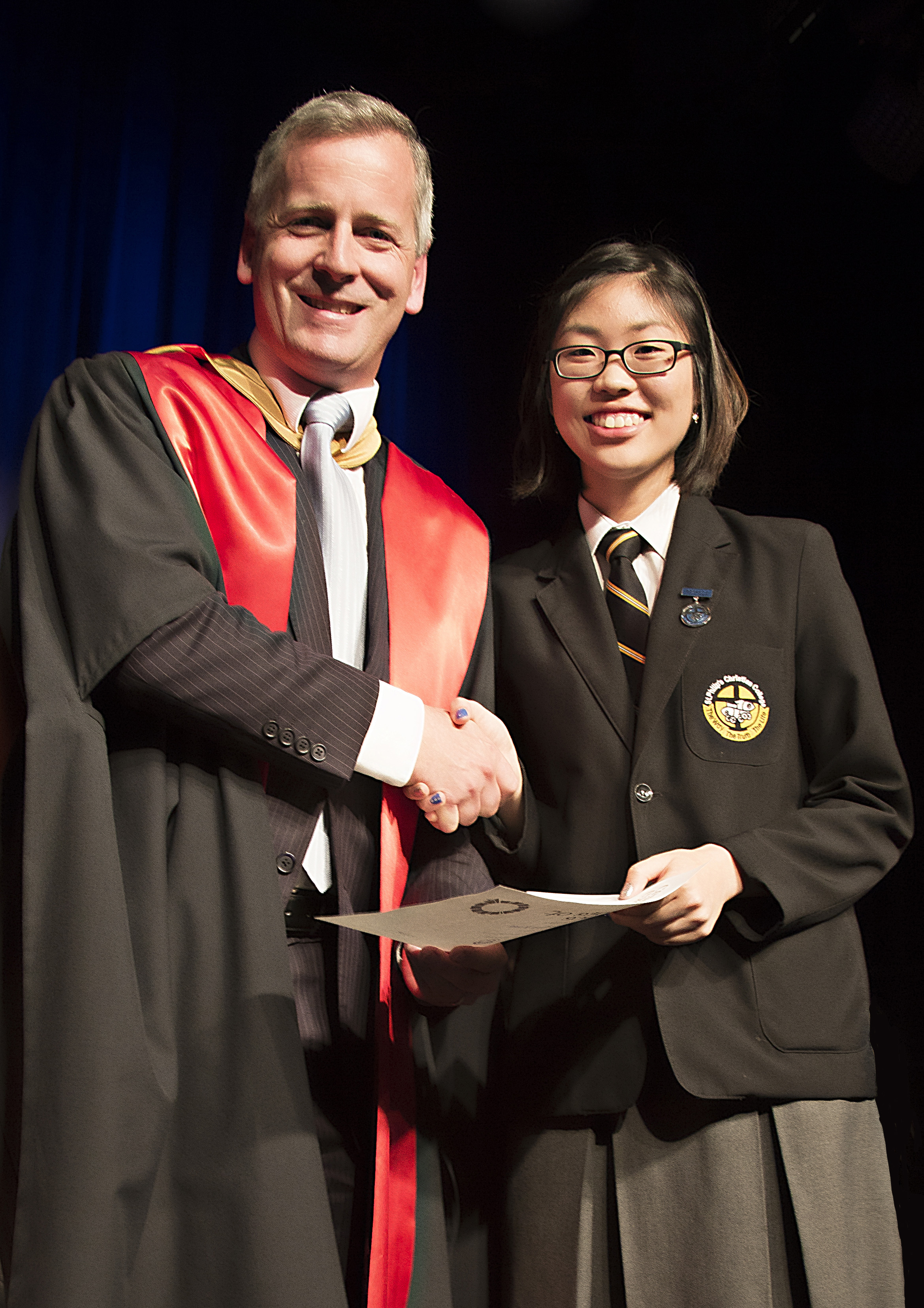 Grace Kim receiving her 2016 Dux Award from Principal Dr Pettersen.  Photo supplied by St Philip's Christian College.